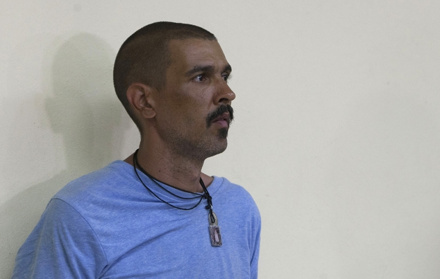 Clifford Brandt stands inside the police office after his arrest in Port-au-Prince, Haiti, Tuesday, August 12, 2014. Brandt was taken into custody in the Haitian town of Cornillon, near the border with the Dominican Republic, Communications Minister Rudy Heriveaux said. (AP Photo/Dieu Nalio Chery)